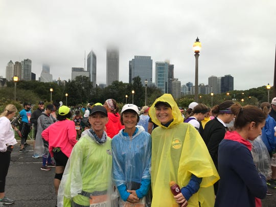Gulf Coast Runners members Sandy Waite, Mary Iamurri, and Dawna Holowell wait for the start of the Chicago Marathon in October. Holowell is the volunteer coordinator for Gulf Coast Runners and has been busy preparing for Sunday's Naples Daily News Half Marathon.