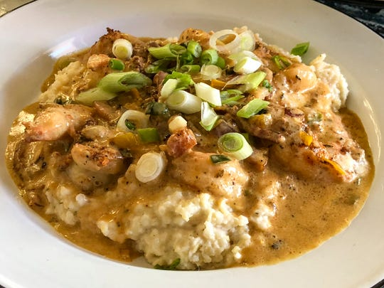Florida Pink Shrimp and Anson Mills Creamy Grits with Broadbent's Bacon and Pepper Pan Sauce for $16. 50 at The Rooster Food and Drink in Naples. The picture was shot for National Southern Food Day that is celebrated all around the United States on January 22nd each year.