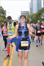 Dawna Holowell shows off her medal for finishing the Chicago Marathon in October. Holowell is the volunteer coordinator for Gulf Coast Runners and has been busy preparing for Sunday's Naples Daily News Half Marathon