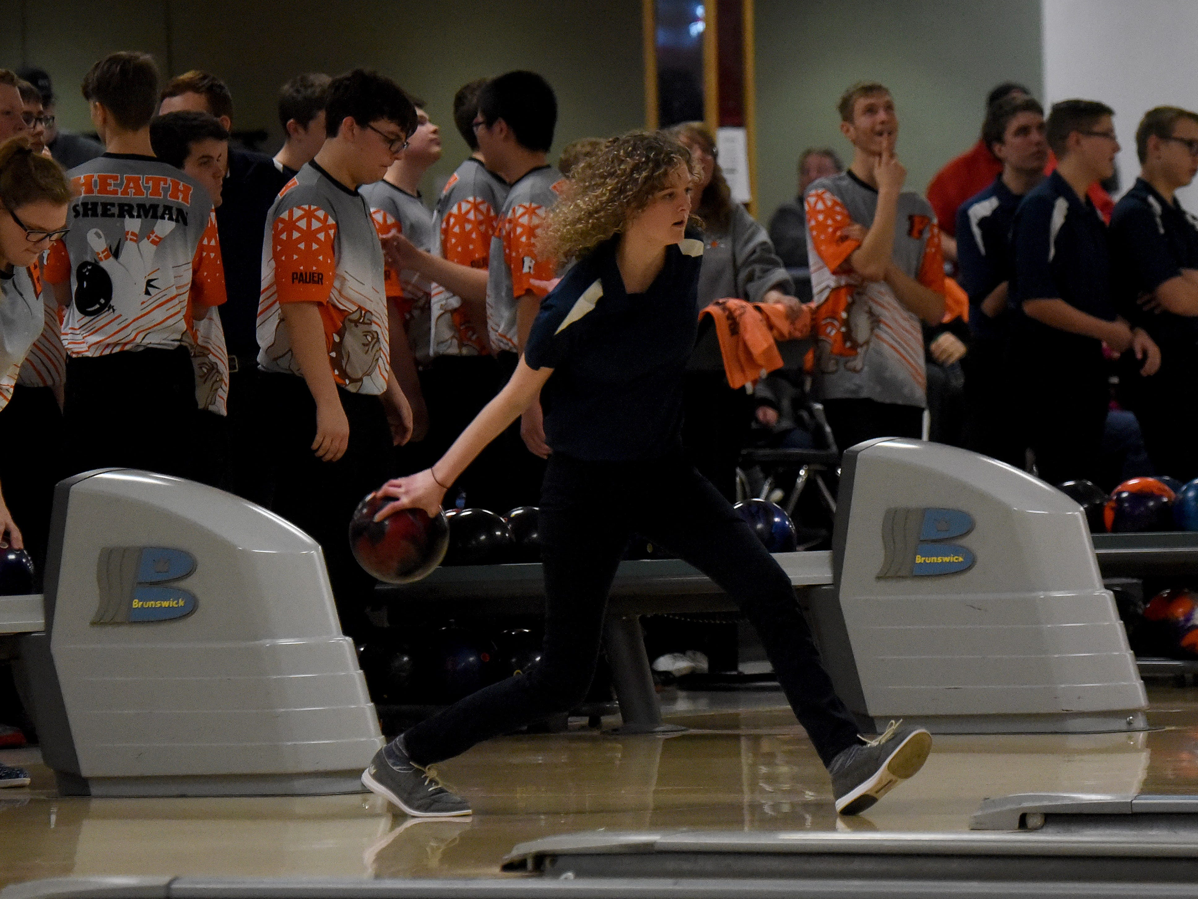 Granville junior Eve Painter bowls with the Blue Aces' bowling team against Granville in an LCL match on Thursday, Jan. 17, 2019, at Park Lanes in Heath.