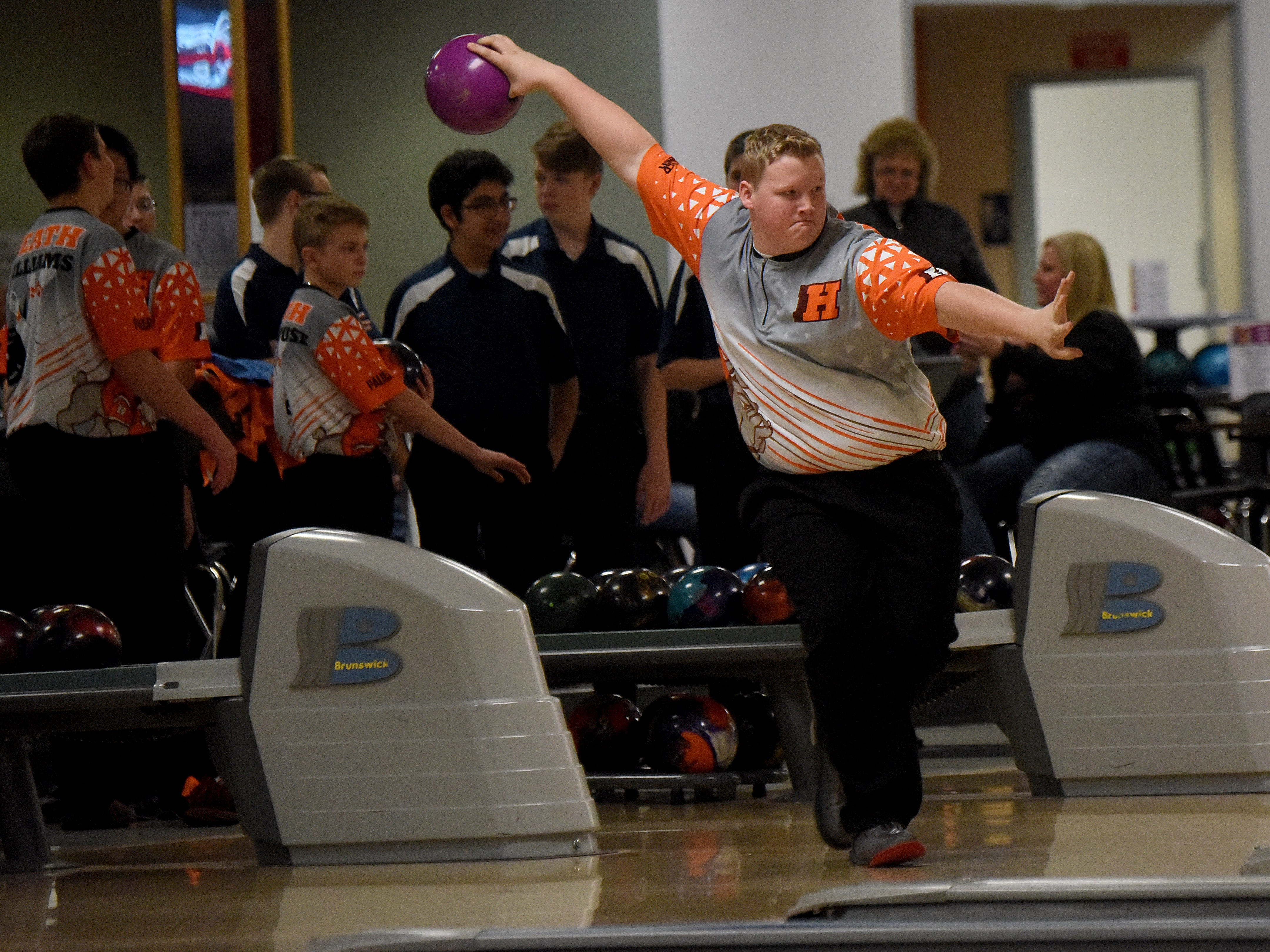 Heath sophomore Korbin Wilson bowls with the Bulldogs' bowling team against Granville in an LCL match on Thursday, Jan. 17, 2019, at Park Lanes in Heath.