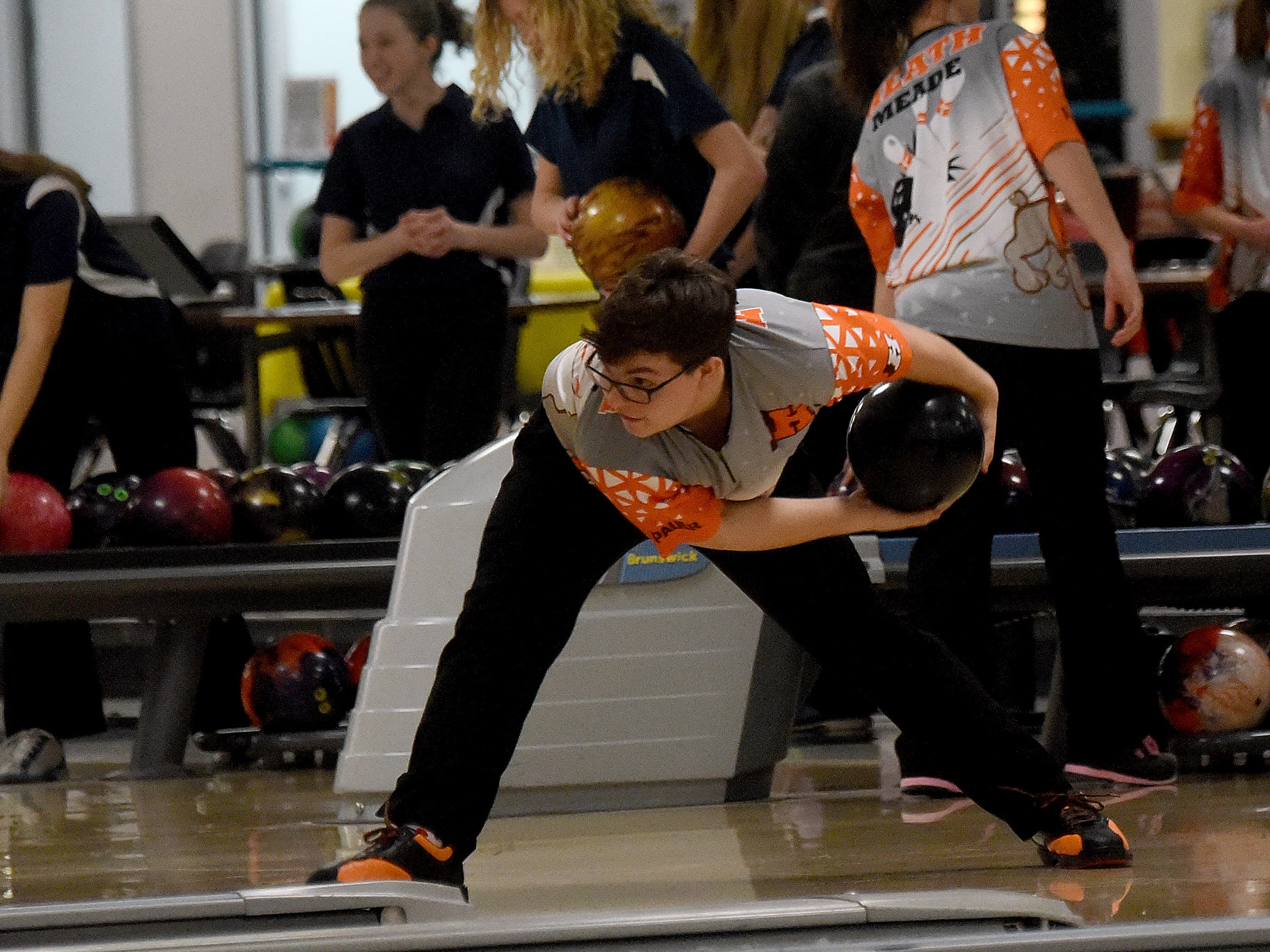 Heath junior Konnor Goodwin bowls with the Bulldogs' bowling team against Granville in an LCL match on Thursday, Jan. 17, 2019, at Park Lanes in Heath.