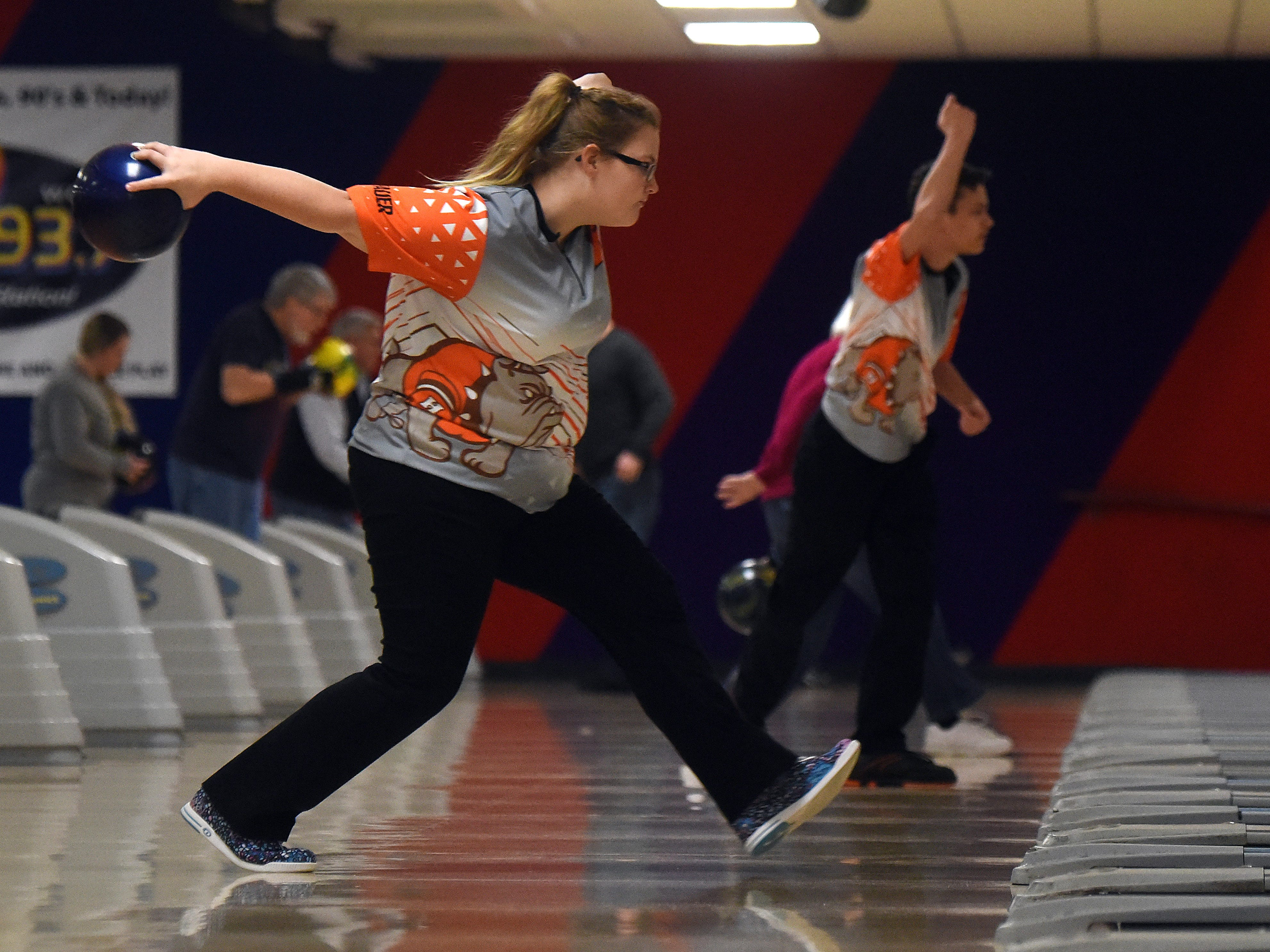 Heath sophomore Kelsey Wilson bowls with the Bulldogs' bowling team against Granville in an LCL match on Thursday, Jan. 17, 2019, at Park Lanes in Heath.