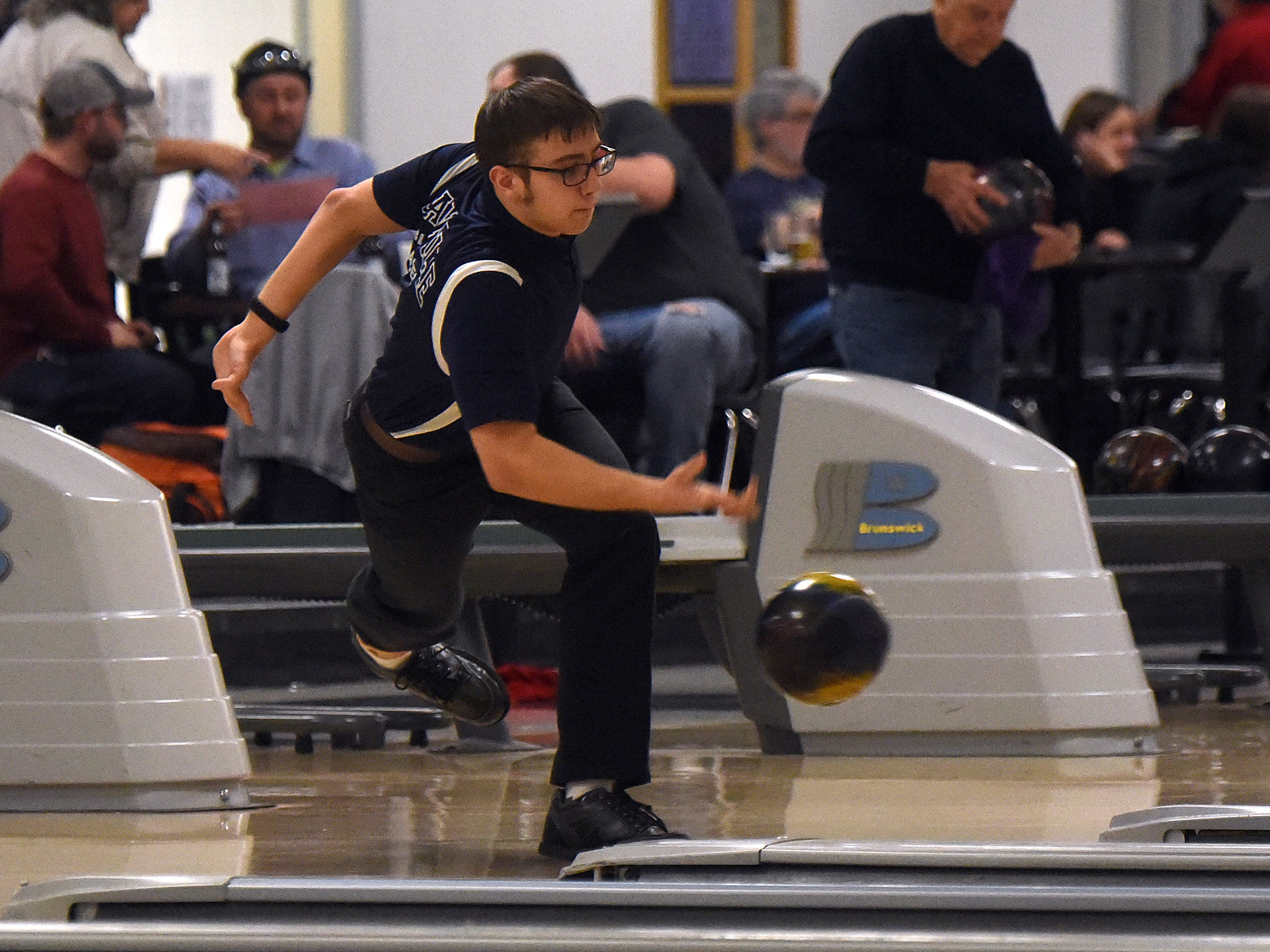 Granville junior Eric Stickley bowls with the Blue Aces' bowling team against Granville in an LCL match on Thursday, Jan. 17, 2019, at Park Lanes in Heath.