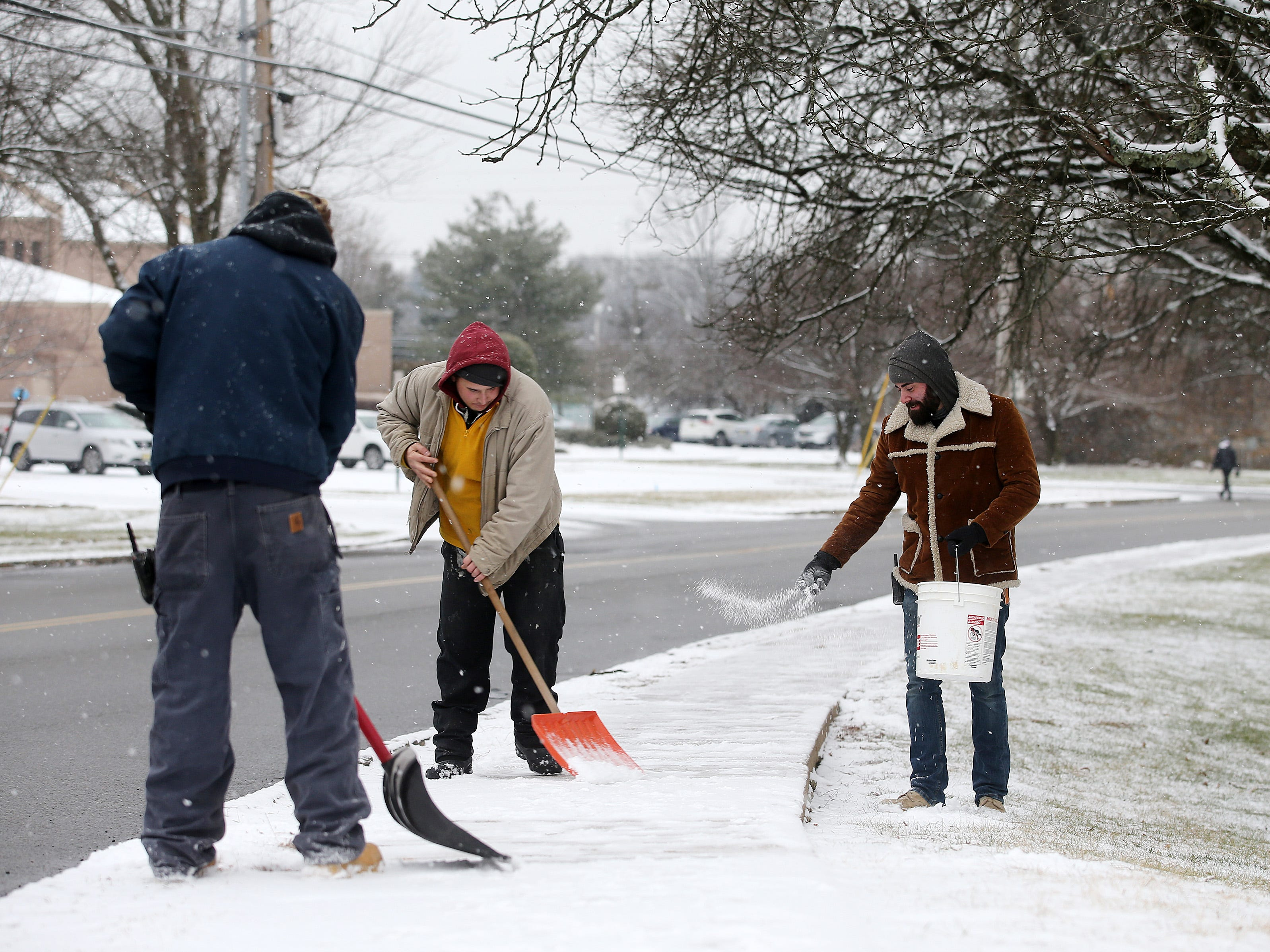 Thomas Titus, James Cina and Carmen Battista, all of Parsippany and maintenance workers for the Baldwin Manor apartment complex, shovel and salt the sidewalks around the complex in Parsippany, NJ Friday January 18, 2019.
