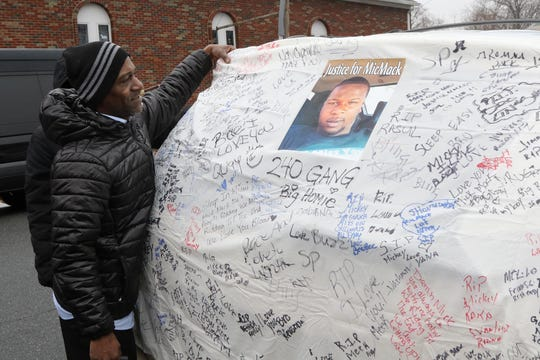 Ron Jones attaches a sheet to a van outside the Canaan Baptist Church with signatures of supporters for Jameek Lowery, a man who died while in Paterson Police custody. Lowery's funeral Mass was taking place at the Paterson church on January 19, 2019.
