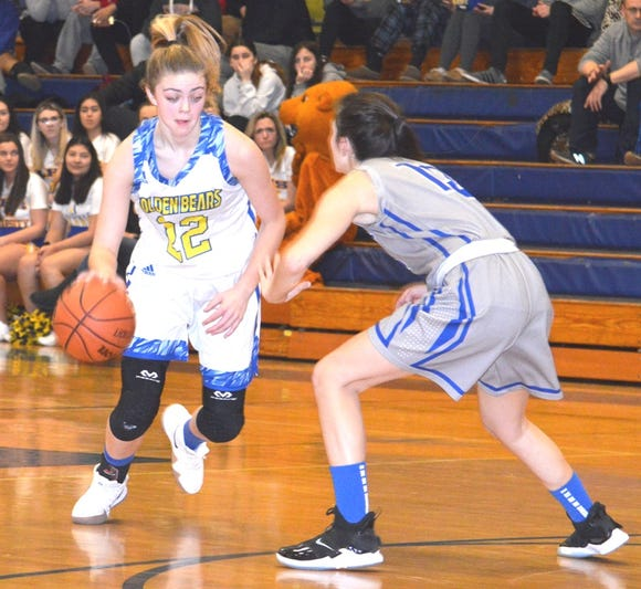 Lyndhurst senior Angela Downey (22) is defended by Ridgefield sophomore Livia Ramos.