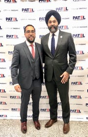 Passaic Councilman Salim Patel and New Jersey Attorney General Gurbir Grewal on Thursday in Passaic. Grewal swore Patel to office in front of crowd at Passaic High School.