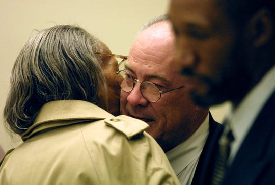 Attorney Mike Kelly gets a hug from the grandmother of John Williams, after a jury acquitted him of murder in the 2001 beating death of a homeless man in Paterson.