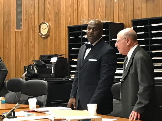Derrick Chestnut, ( L ), with his attorney John Weichsel as the trial began.