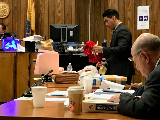 Assistant prosecutor Jonathan Barrera showing the jury the clothing the alleged victim was wearing during the attack.