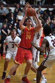 Bergen Catholic's Matt Zona (24), shown here in last month's loss at Don Bosco, scored a team-high 17 points in a 61-45 home win over the Ironmen in Oradell on Thursday, Feb. 14, 2019.