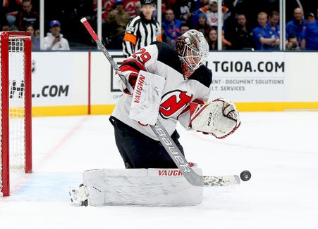 Jan 17, 2019; Uniondale, NY, USA; New Jersey Devils goaltender Mackenzie Blackwood (29) makes a save against the New York Islanders during the second period at Nassau Veterans Memorial Coliseum.