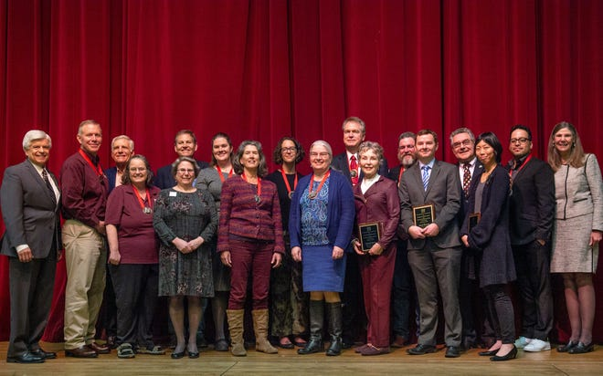 The recipents of the Excellence in Assessment Award, the Donal C. Roush Award and the University Research Council Award for Exceptional Achievements in Creative Scholarly Activity. Back Row, Chancellor Dan Arvizu, left,  Joseph M Berning,  Keith Mandabach, Terry Adler, Catherine Brewer, Krista Kozel MacDonald, Shaun H. Cooper, Frank Hodnett, President John Floros, Ernesto Moralez, and Interim Provost April Mason, Front Row: Beth Humphreys, Dr. Jean Hertzman, Erin O'Neill Armendarez, Robyn Hayes, Patricia Hynes, David G.M Mitchell, Motoko Furuhashi Tuesday January 14, 2018 at Atkinson Music Recital Hall.