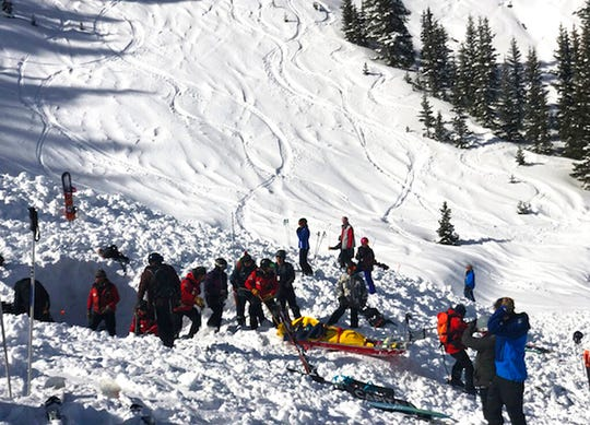 People search for victims after an avalanche buried multiple people near the highest peak of Taos Ski Valley, one of the biggest resorts in New Mexico, Thursday, Jan. 17, 2019. The avalanche rushed down the mountainside of the New Mexico ski resort on Thursday, injuring at least a few people who were pulled from the snow after a roughly 20-minute rescue effort, a resort spokesman said.