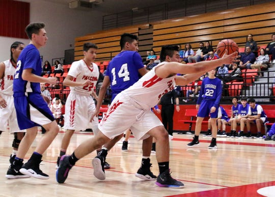 Kevin Porras streches to save a ball in the first half of Thursday's game against the Carlsbad JV. Carlsbad won, 47-43.