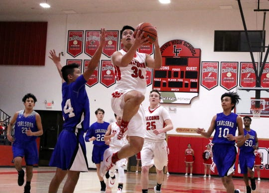 Kevin Gut-omen takes a contested layup during Thursday's game against the Carlsbad JV. Carlsbad won, 47-43.