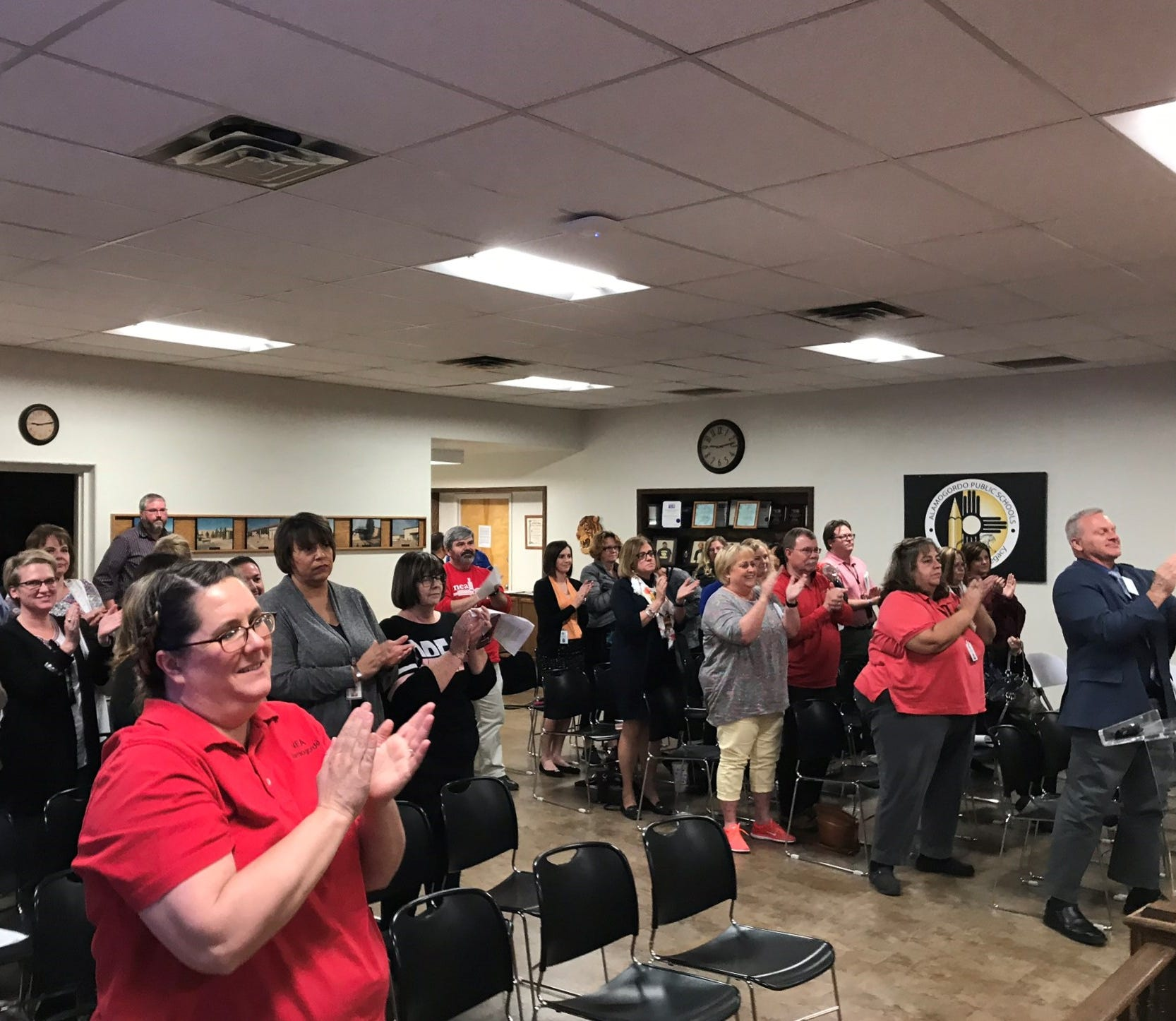 The Alamogordo Public School District board meeting room erupted in a standing ovation for the board's decision to name Jerrett Perry APS superintendent. Perry has been serving as acting/interim superintendent since September.