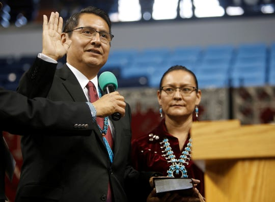 Jonathan Nez is sworn into the Navajo Nation presidential office on Tuesday at the Bee Hółdzil Fighting Scouts Events Center in Fort Defiance, Ariz.