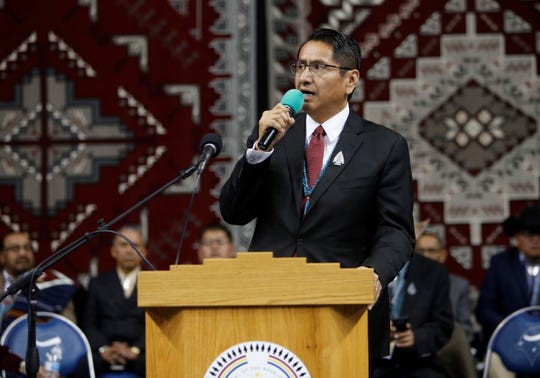 Navajo Nation President Jonathan Nez announces several cabinet nominees during his inaugural address Tuesday at the Bee Hółdzil Fighting Scouts Events Center in Fort Defiance, Ariz.