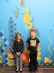 """Elizabeth and Aiden are proud to be Sierra Vista Primary """"student Spotlight"""" winners. Aiden is especially happy as he will be turning eight soon, and Elizabeth likes school a lot."""
