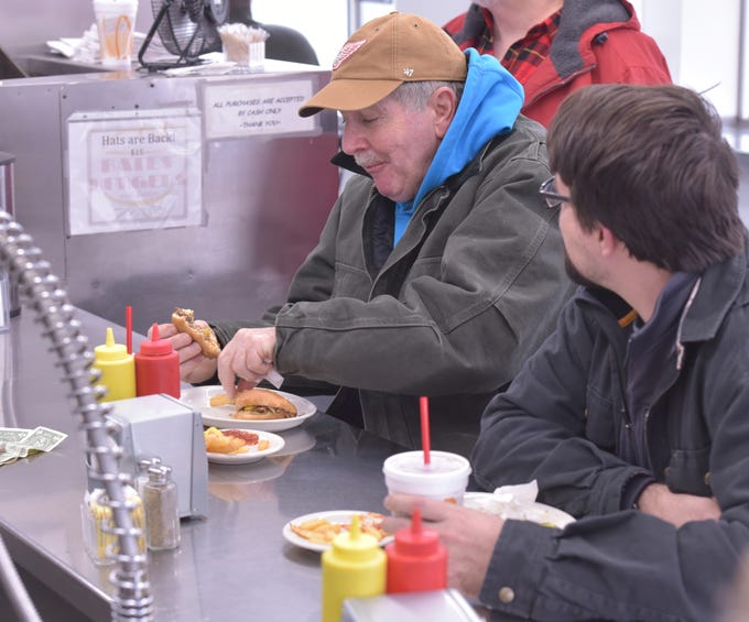 Frank Purrington, left, of Dearborn Heights, and Kyle Conner of Ferndale, polish off their Jan. 17 lunches at Bates Burger. Purrington said he'd been coming to Bates for about 30 years now.
