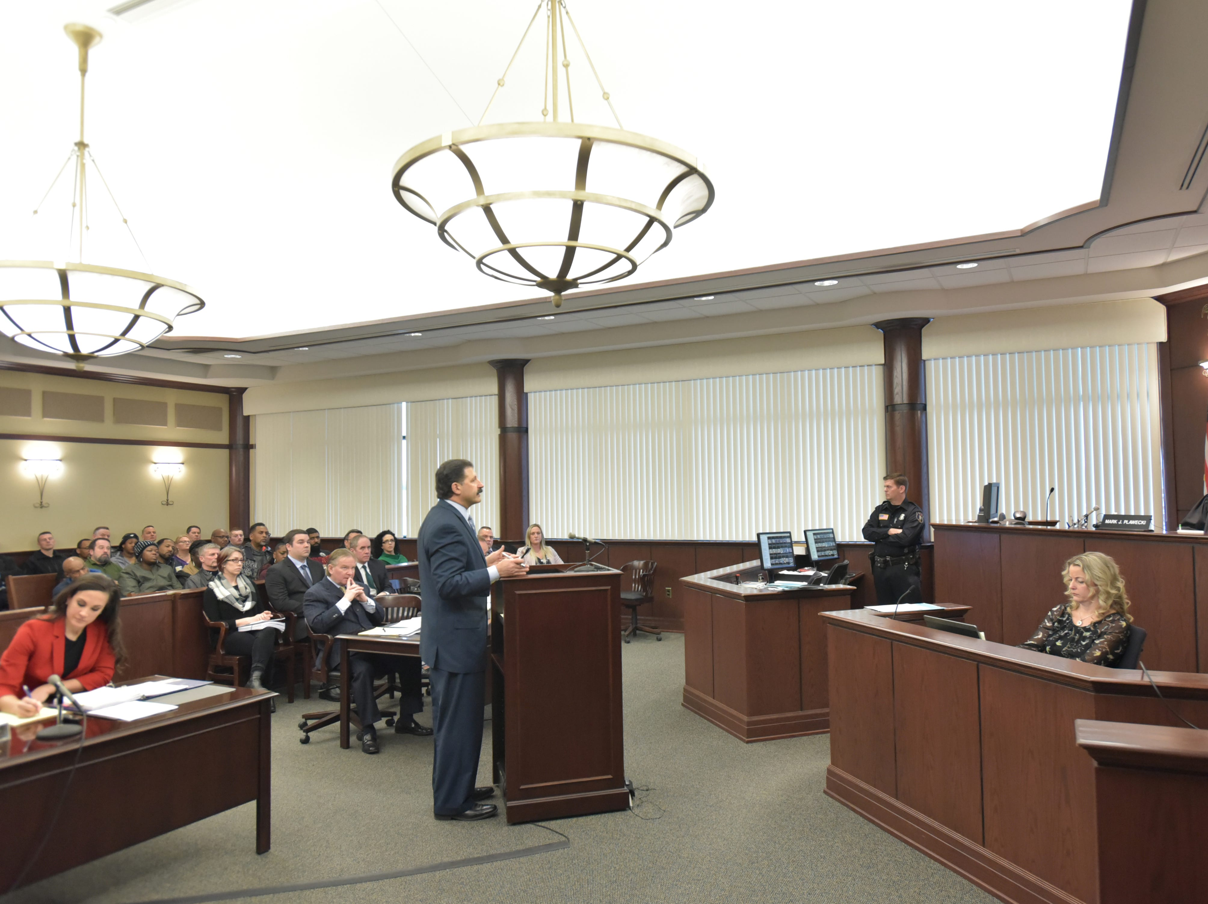 Attorney Marc Hart, representing paramedic Matt Dicosola, discusses the case against his client with Judge Mark Plawecki in the Dearborn Heights courtroom on Jan. 18.