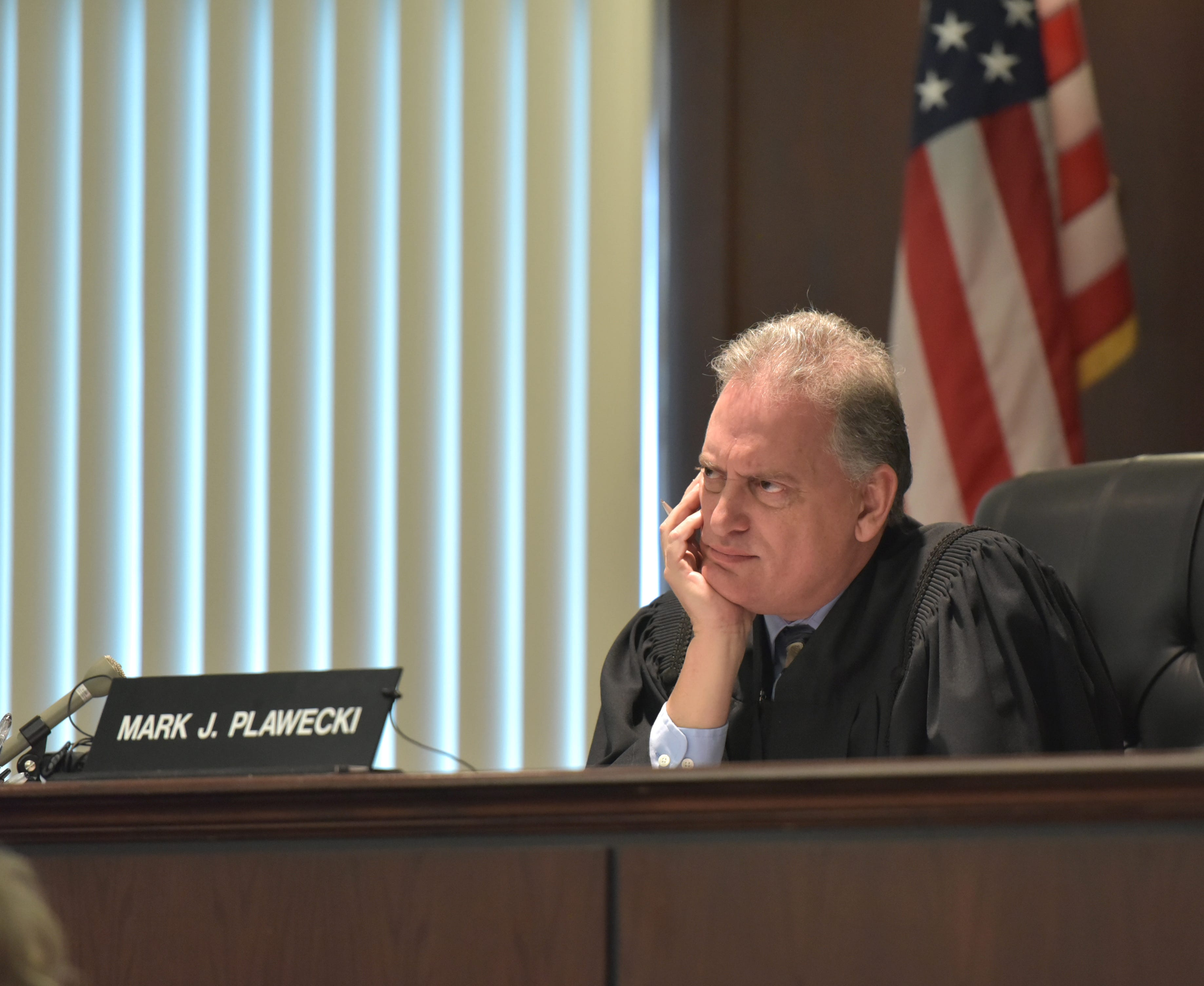 Judge Mark J. Plawecki listens to information given in a preliminary exam of defendants Ronald Buckley, Matt Dicosola and Leah Maynard at the Dearborn Heights courtroom on Jan. 18.