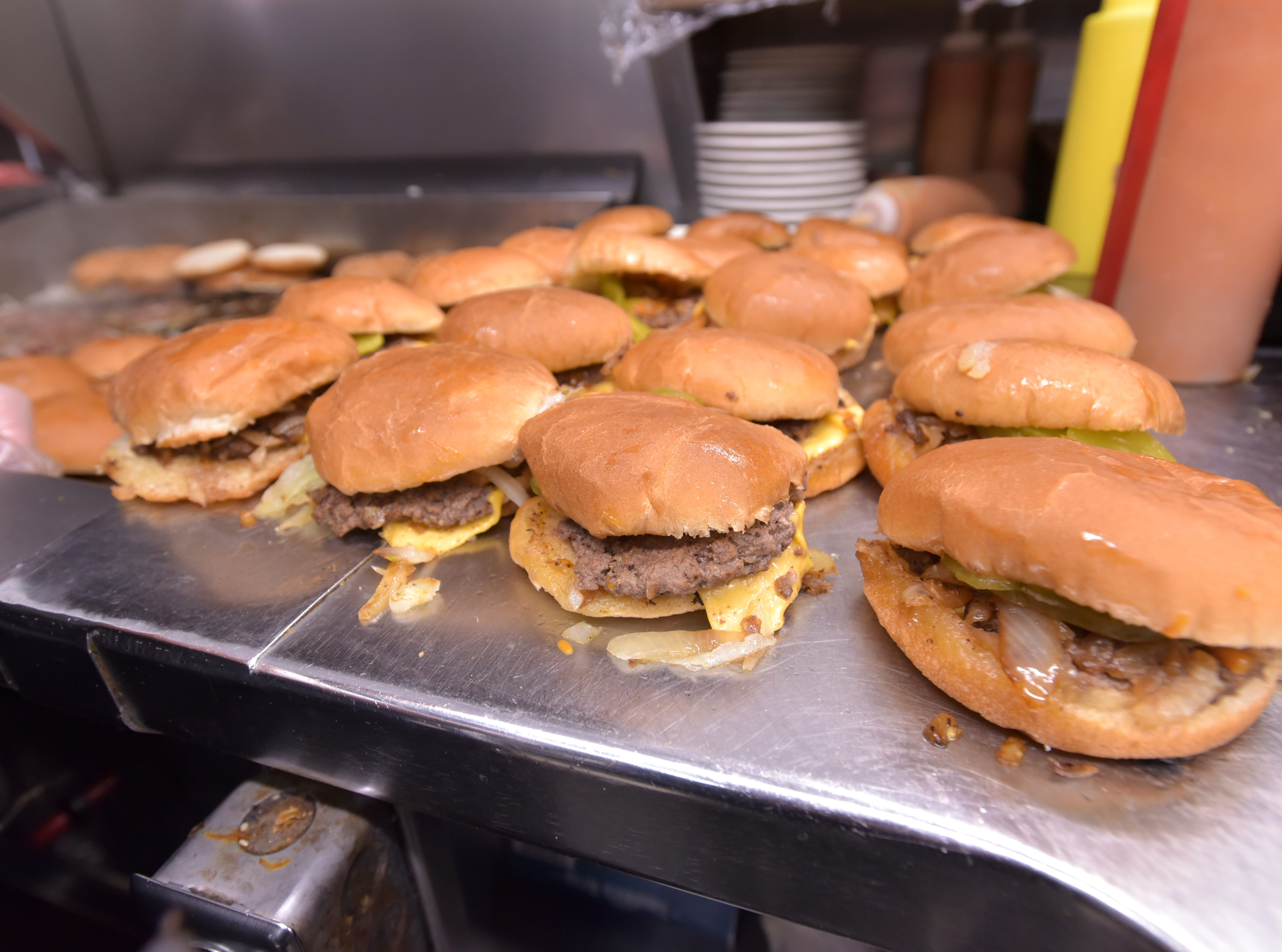 This is what brings them in: Bates Burgers with cheese and grilled onions.