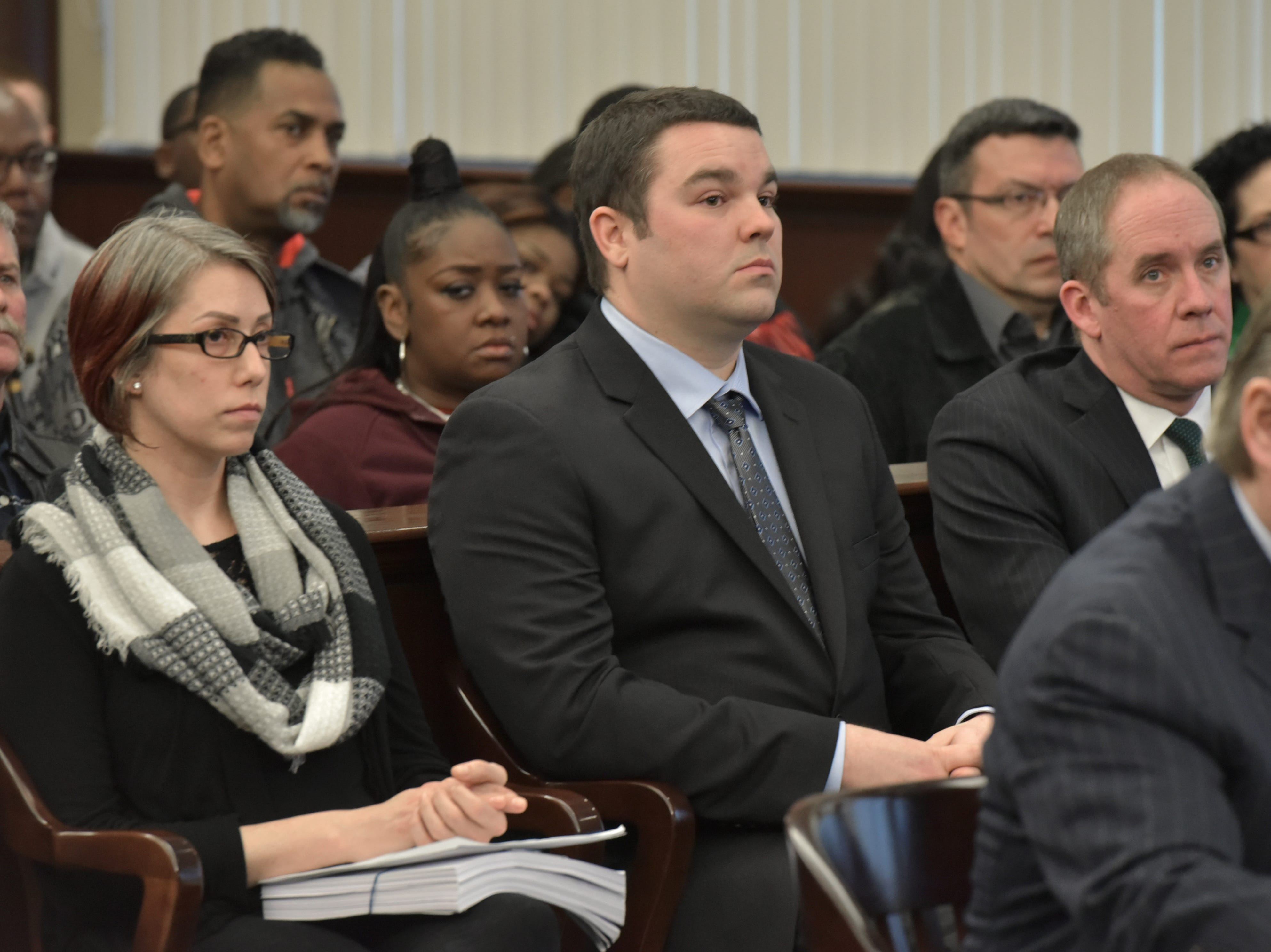 Defendants, from left, Leah Maynard, Matt Dicosola, both paramedics, and former police sergeant Ronald Buckley (not pictured) at their Jan. 18 preliminary exam in Dearborn Heights.