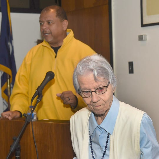 Mayor Julius Alsandor is introduced to the audience by Estelle Perrault at the Opelousas Public Library. Alsandor told the group he will try to help solve funding and maintenance problems at the library.