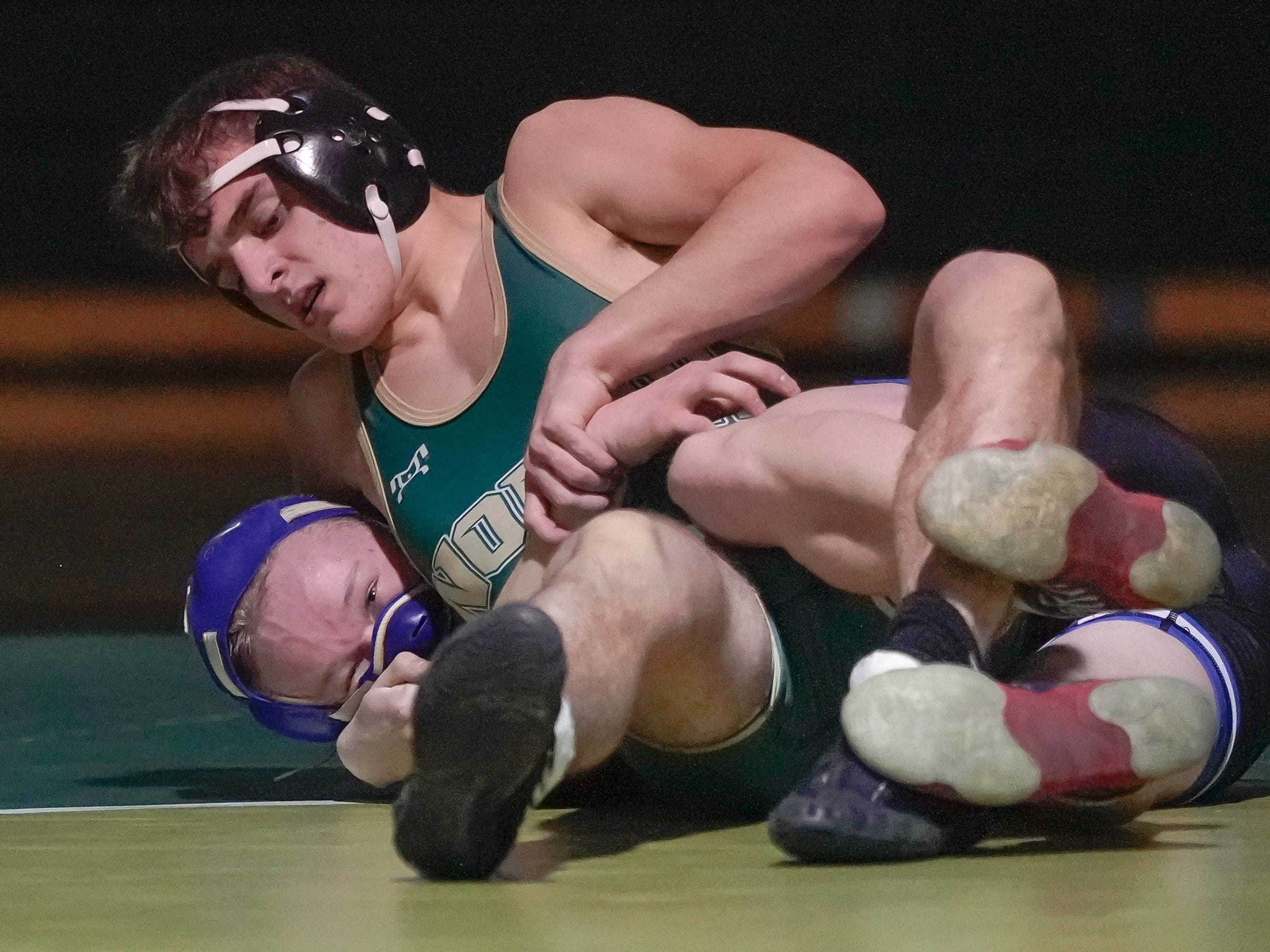 Landon Spanbauer of Oshkosh North and Carson Hollis of Oshkosh West wrestle in the 145-pound weight class. The Oshkosh North Spartans hosted the Oshkosh West Wildcats in a Fox Valley Association wrestling match Thursday evening, January 17, 2019.