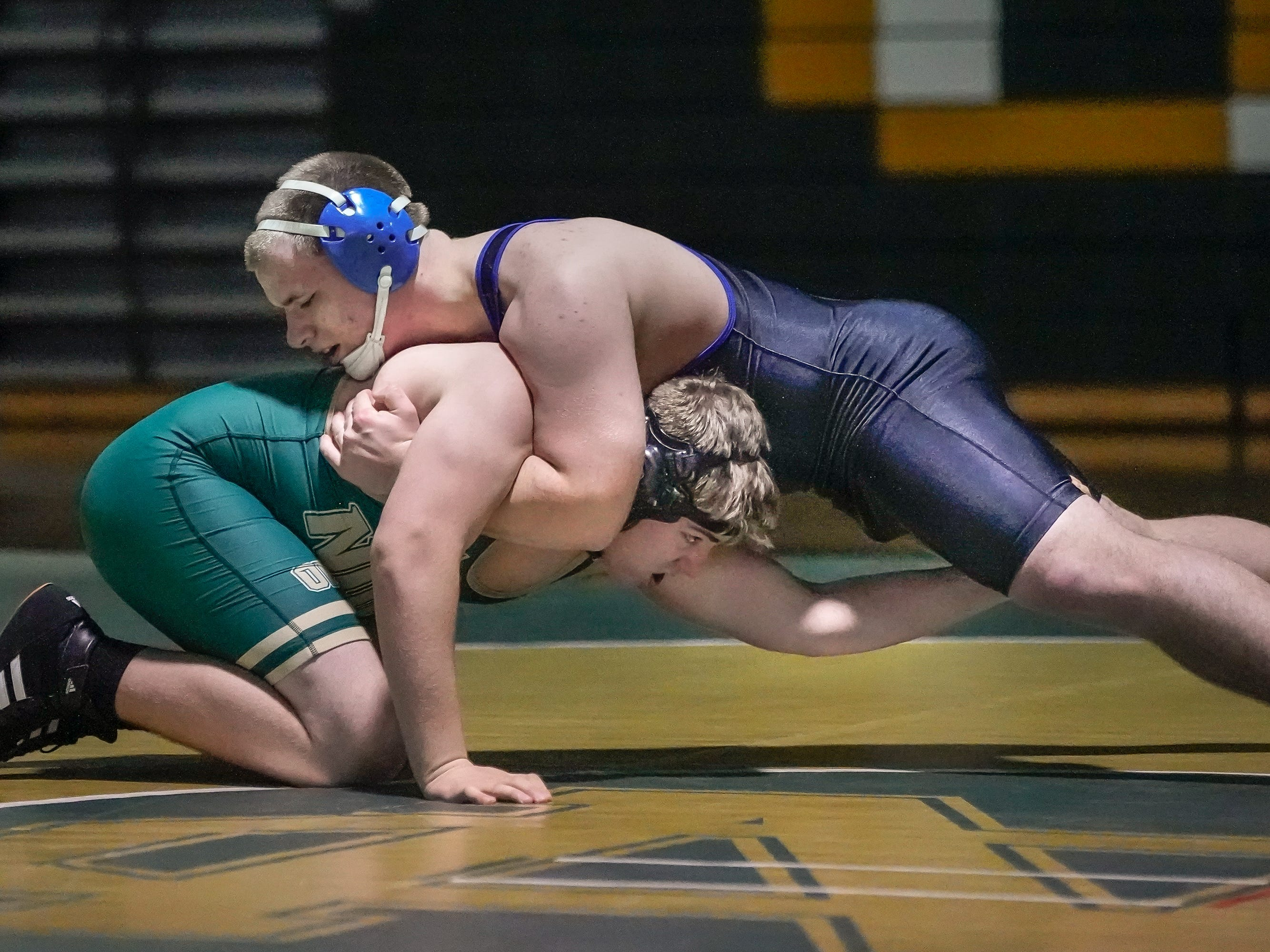 Matthew Mathusek  of Oshkosh North and Justin Oppermann of Oshkosh West wrestle in the 220-pound weight class. The Oshkosh North Spartans hosted the Oshkosh West Wildcats in a Fox Valley Association wrestling match Thursday evening, January 17, 2019.
