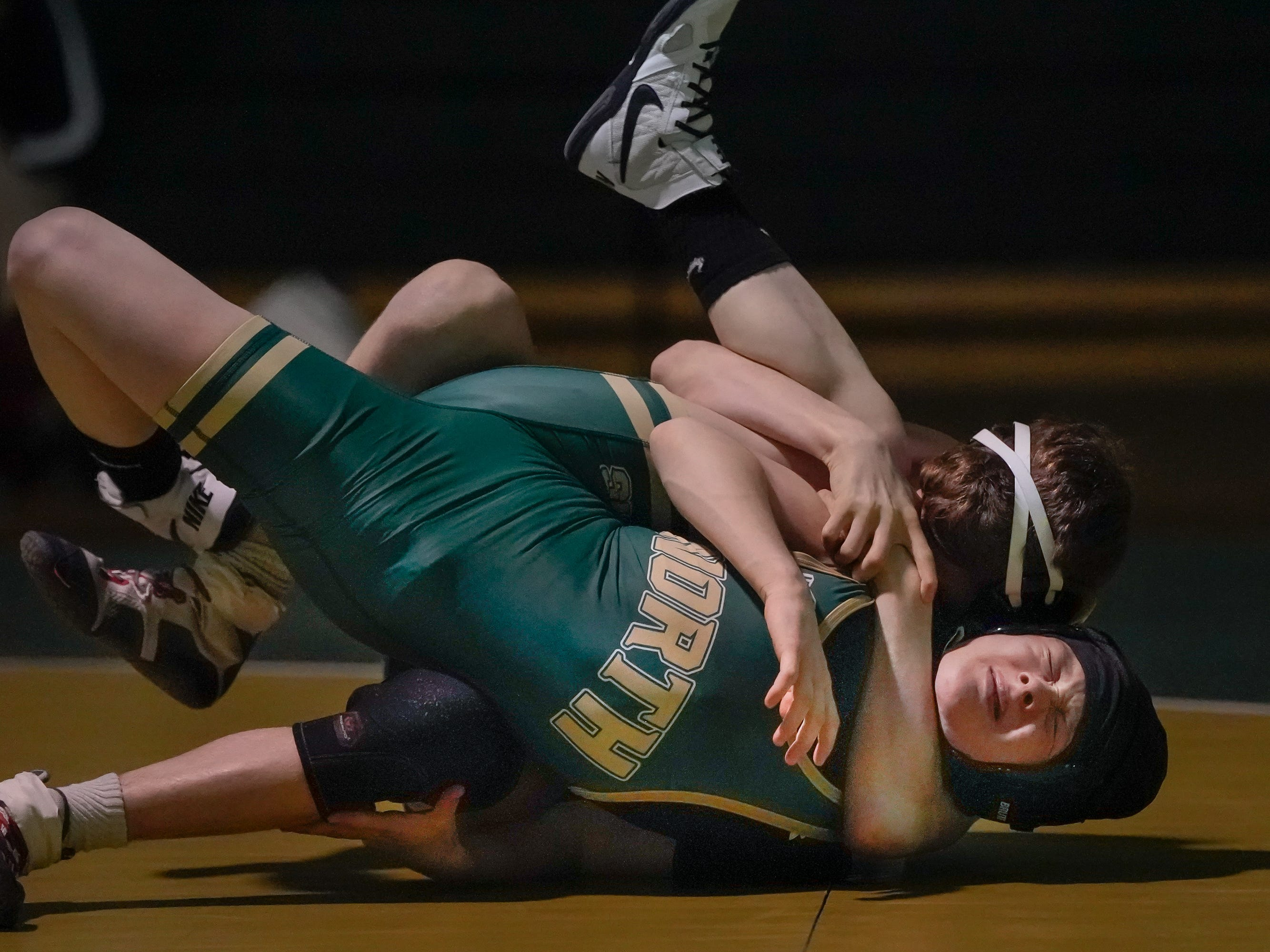 Alec Hunter of Oshkosh West and Carley Ochoa of Oshkosh North wrestle in the 113-pound weight class. The Oshkosh North Spartans hosted the Oshkosh West Wildcats in a Fox Valley Association wrestling match Thursday evening, January 17, 2019.