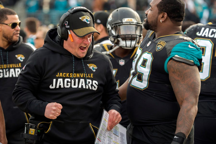 Jacksonville Jaguars offensive coordinator Nathaniel Hackett celebrates with Jaguars defensive tackle Marcell Dareus (99) during the second half of an NFL wild-card playoff football game against the Buffalo Bills, Sunday, Jan. 7, 2018, in Jacksonville, Fla. Jaguars beat the Bills 10-3. (AP Photo/Stephen B. Morton)