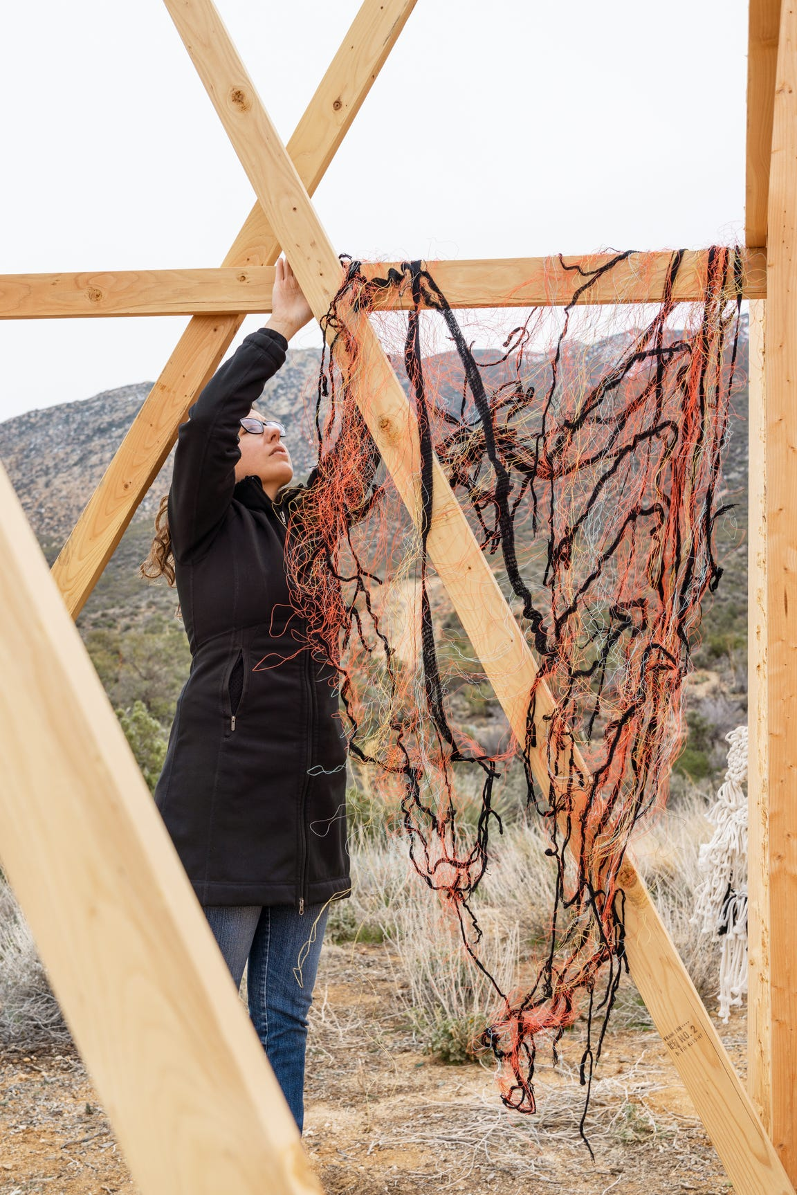 Artist Annette Heully works on her piece for Looming Shelter, a parallel project during Desert X 2019, at Makerville Studio.