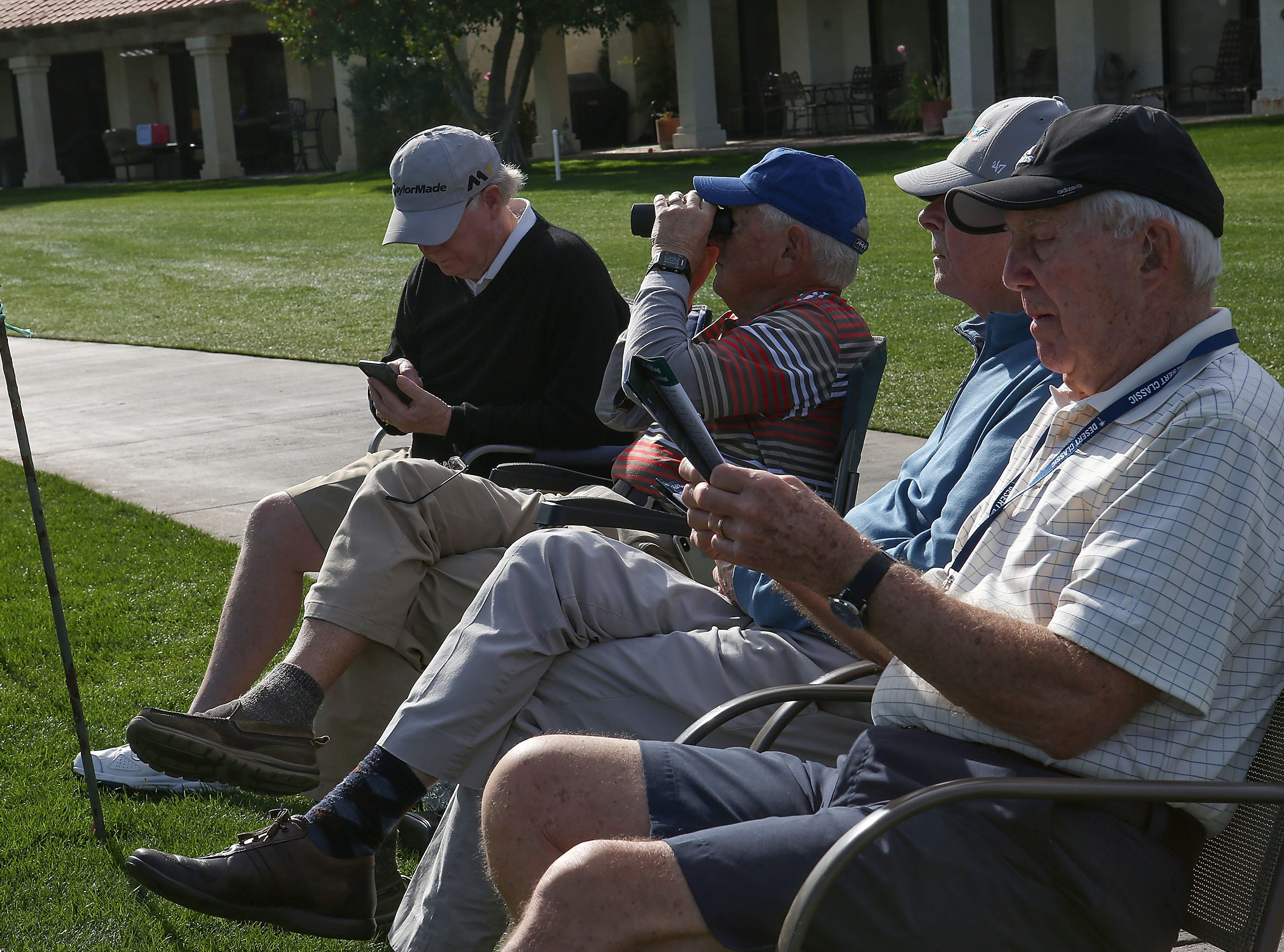 A group of men take in the golf action on the 10th teebox at La Quinta Country Club during the Desert Classic, January 18, 2019.