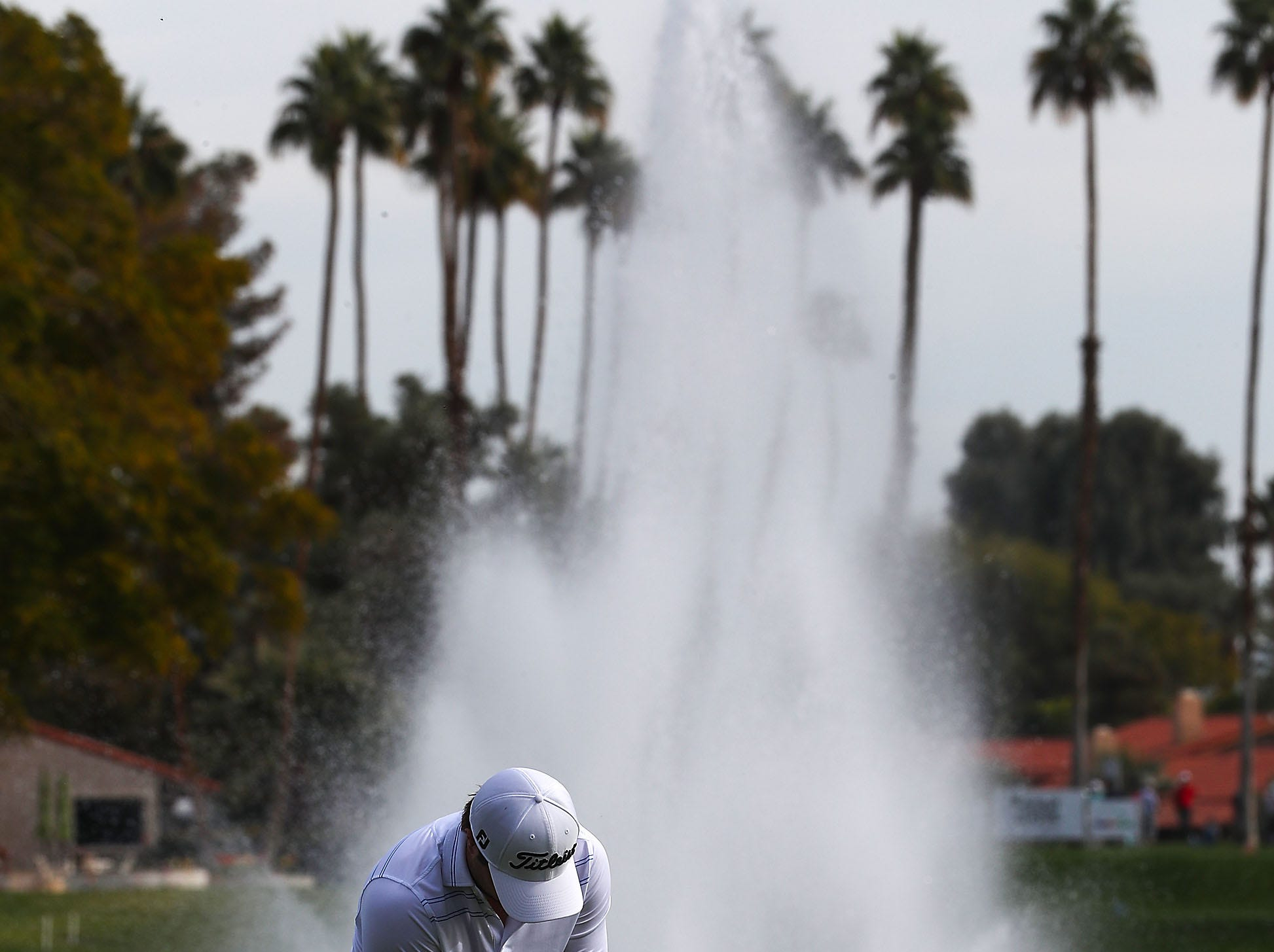 A golfer putts at the La Quinta Country Club during the Desert Classic, January 18, 2019.
