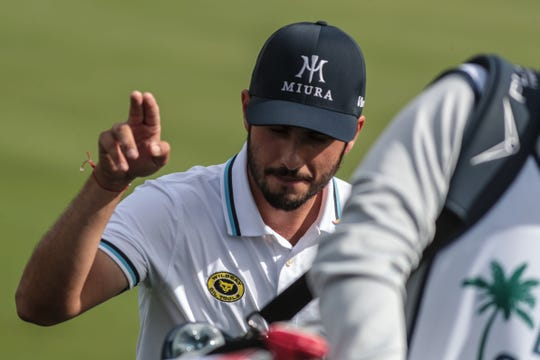 Abraham Ancer acknowledges fans as he transits to 10-tee on the Nicklaus Tournament Course at PGA West in La Quinta during the 2nd round of the Desert Classic on Friday, January 18, 2019.