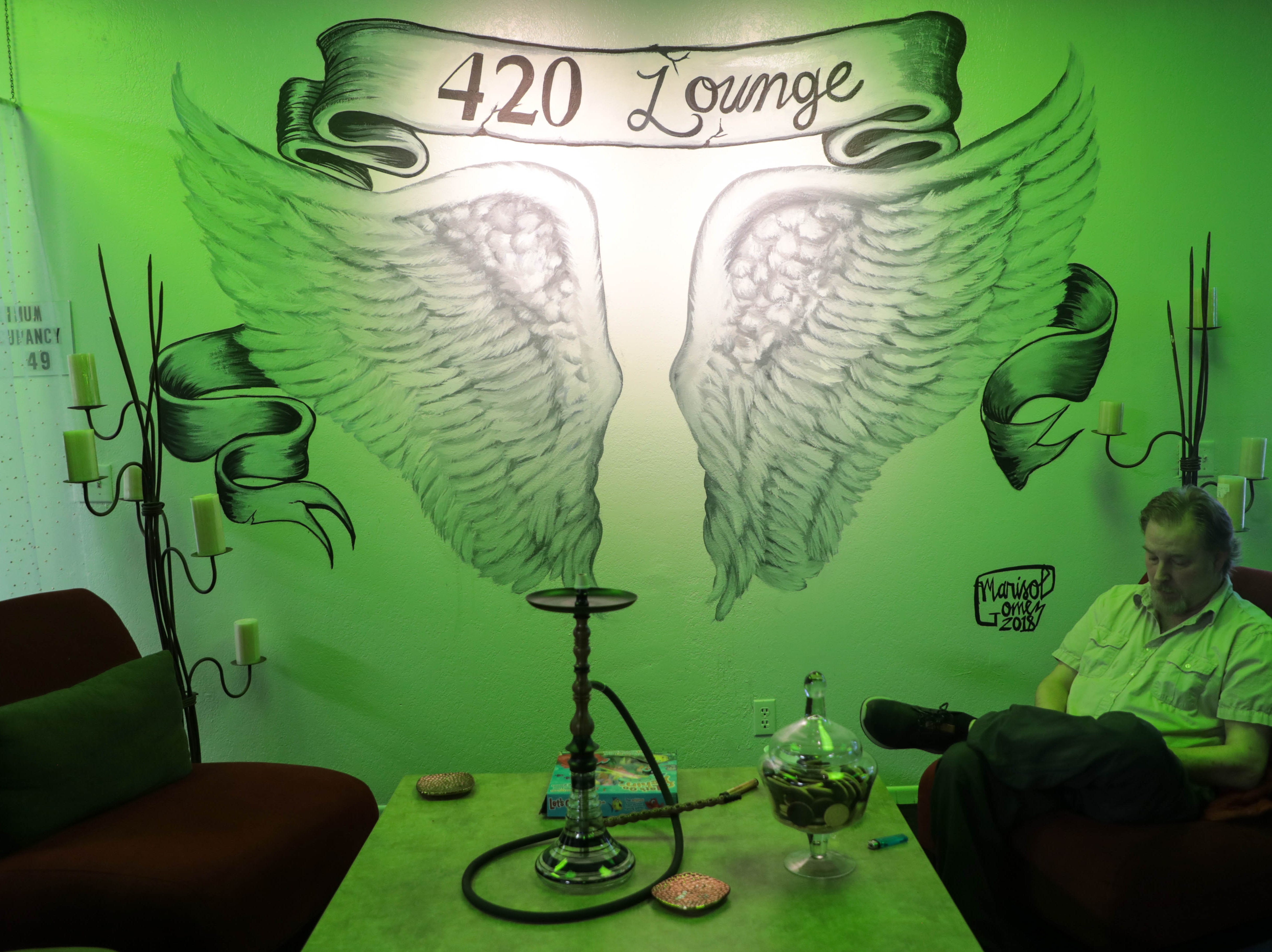 A customer sits inside The 420 Lounge on Thursday, January 17, 2019. The 420 Lounge is the first legal cannabis smoking lounge in Palm Springs, Calif.