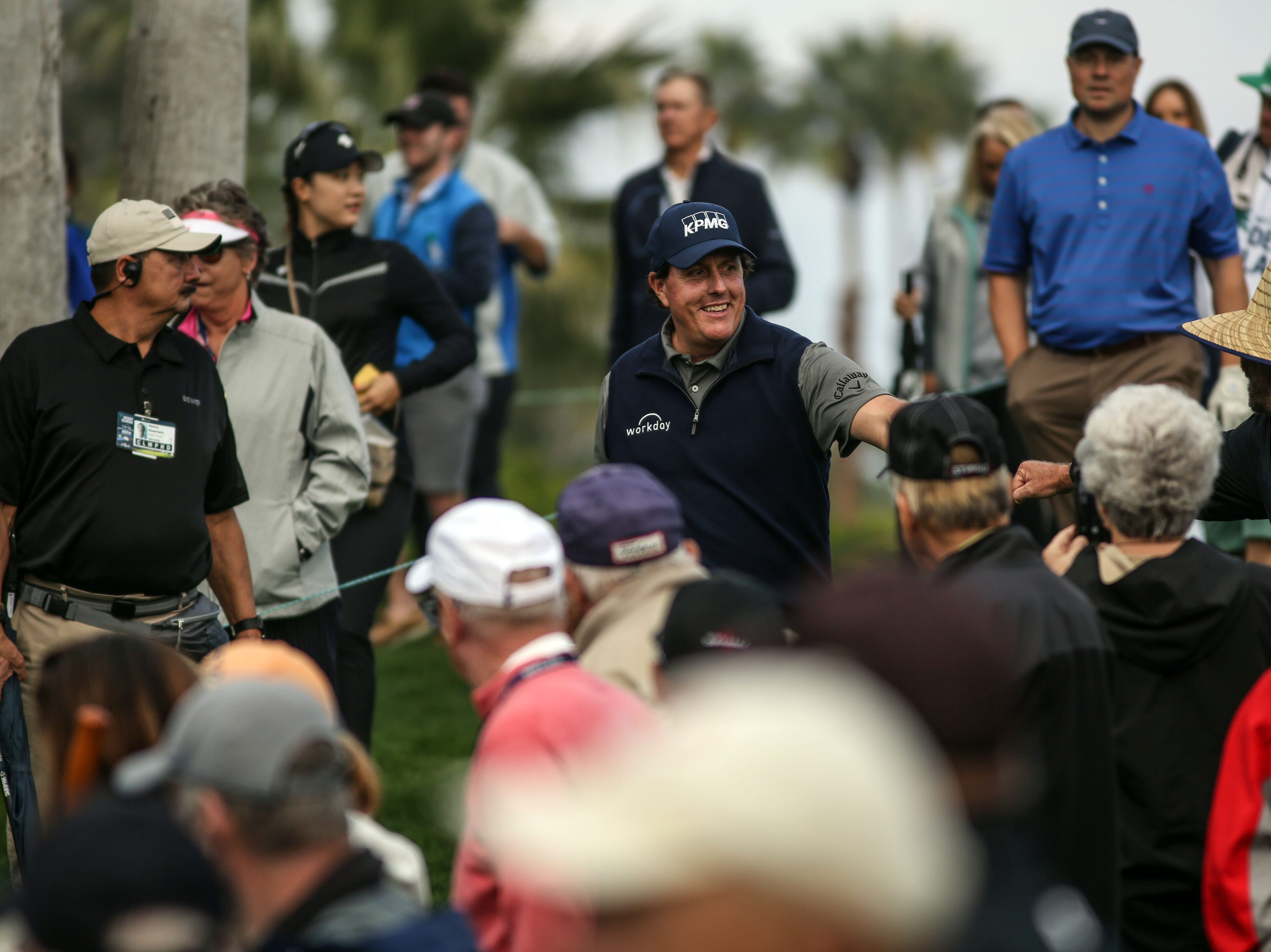 Phil Mickelson fist bumps a fan as he moves to the 18 tee at La Quinta County Club during the 1st round of the Desert Classic on Thursday, January 17, 2019. Mickelson leads at the end of the day with 12 under.