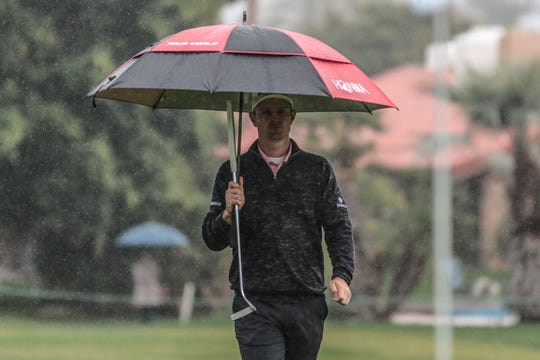 Justin Rose in the rain on 8 at La Quinta County Club during the 1st round of the Desert Classic on Thursday, January 17, 2019.