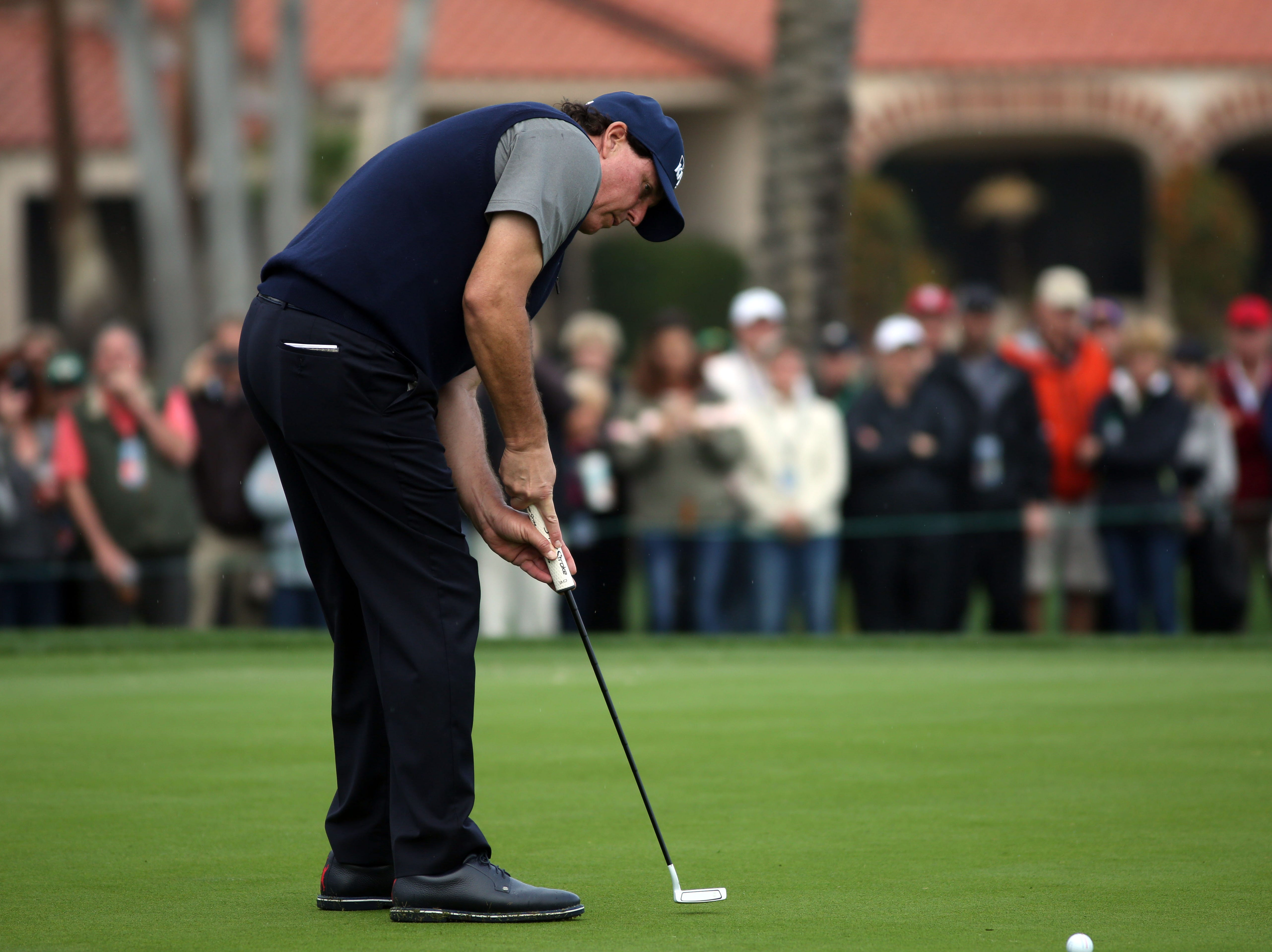 Phil Mickelson birdies 18 at La Quinta County Club during the 1st round of the Desert Classic on Thursday, January 17, 2019. Mickelson leads at the end of the day with 12 under.