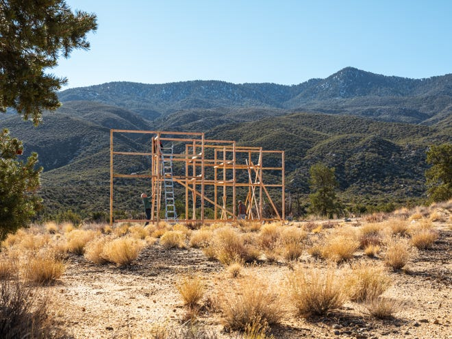 Makerville Studio volunteers begin construction on the wood structure that will serve as the base for Looming Shelter, a parallel project during Desert X 2019.