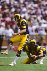 Kicker Mike Lansford #1 and Steve Dils 8 of the Los Angeles Rams attempt a field goal during the game against the San Francisco 49ers at Anaheim Stadium on September 14, 1986 in Anaheim, California.   The Rams won 16-13.