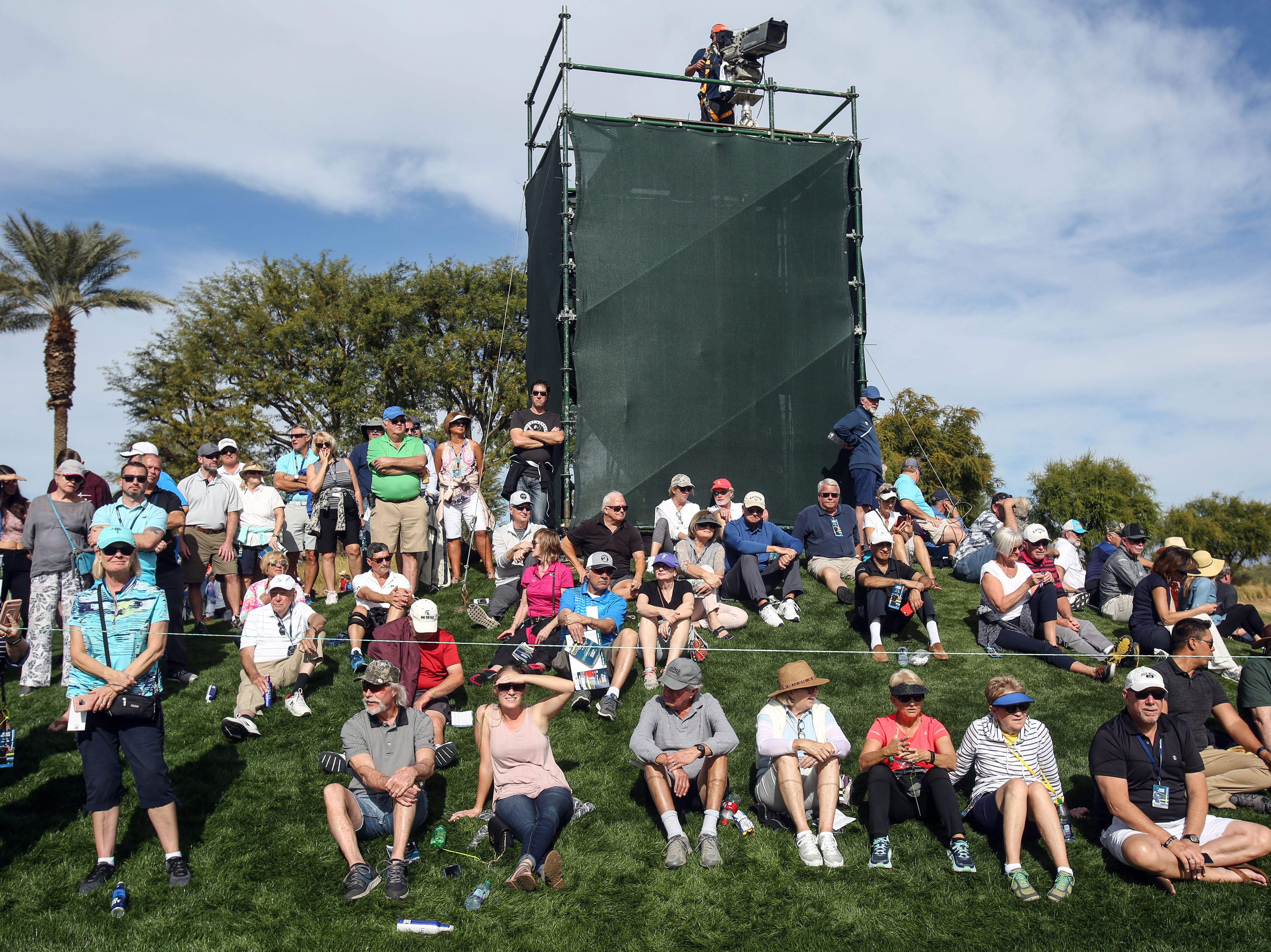 Spectators watch for Phil Mickelson on the Nicklaus Tournament Course at PGA West in La Quinta during the 2nd round of the Desert Classic on Friday, January 18, 2019.
