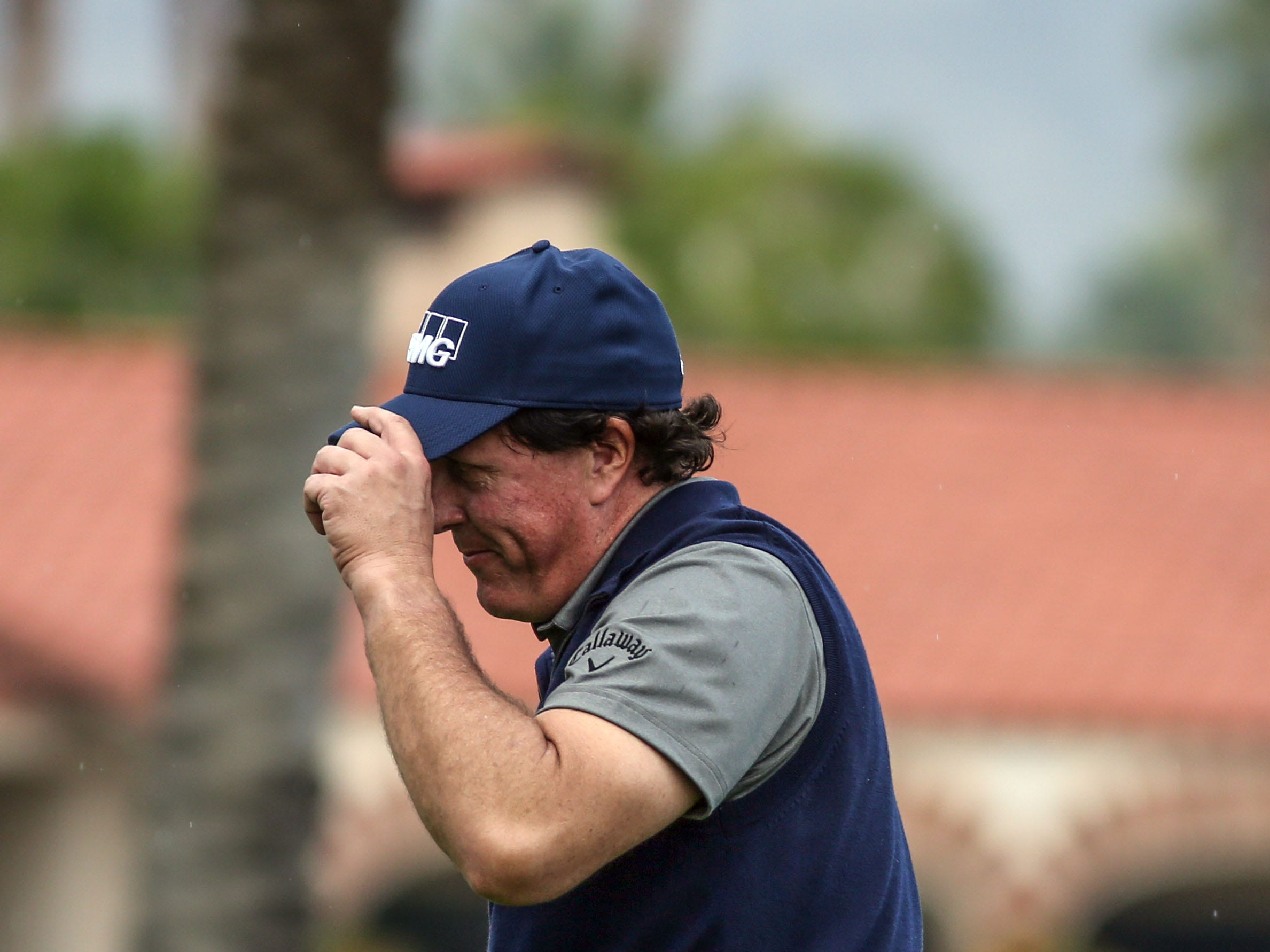 Phil Mickelson tips his cap on 18 at La Quinta County Club during the 1st round of the Desert Classic on Thursday, January 17, 2019. Mickelson leads at the end of the day with 12 under.