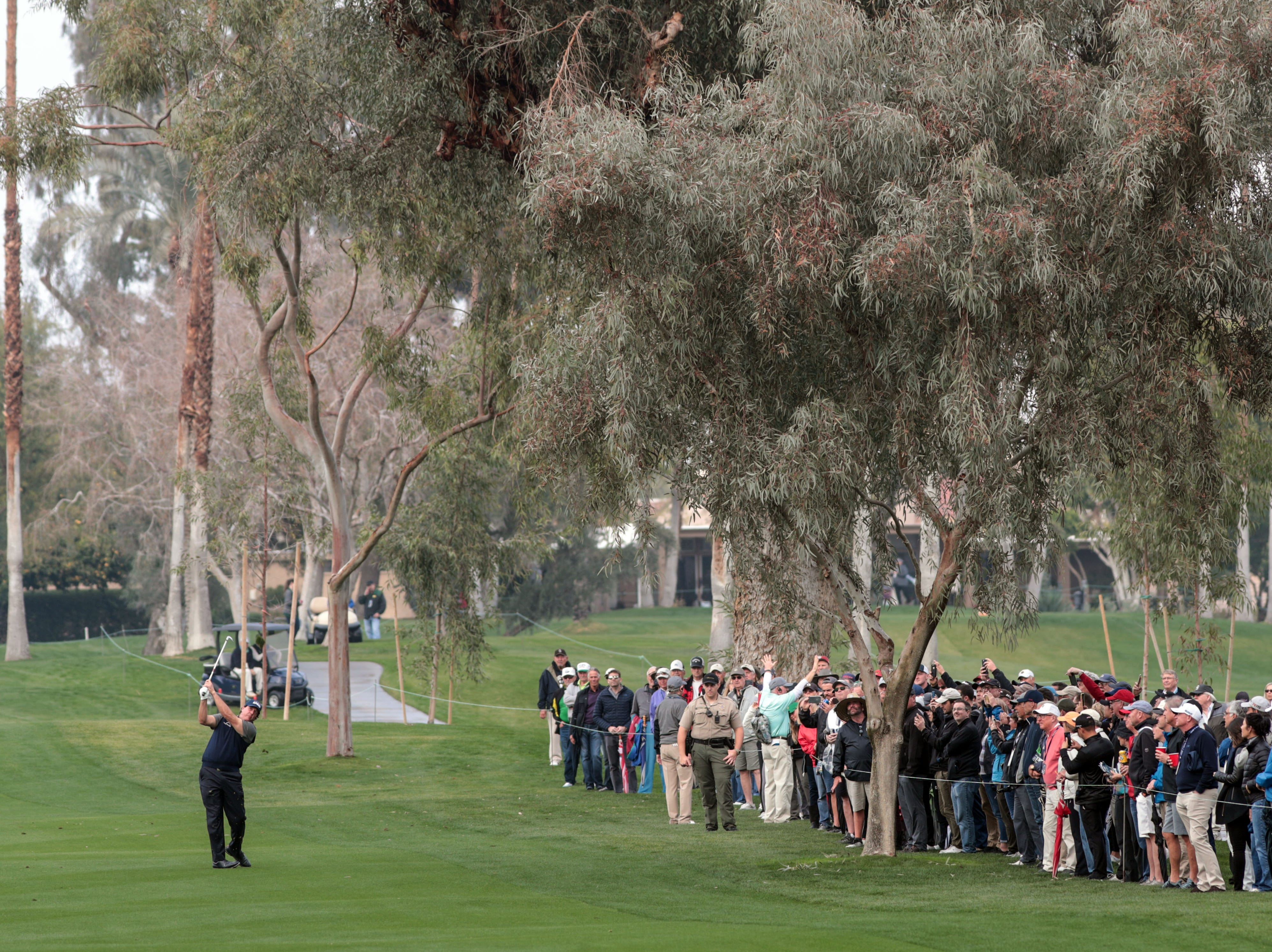 Phil Mickelson hits his approach shot at La Quinta County Club during the 1st round of the Desert Classic on Thursday, January 17, 2019. Mickelson leads at the end of the day with 12 under.
