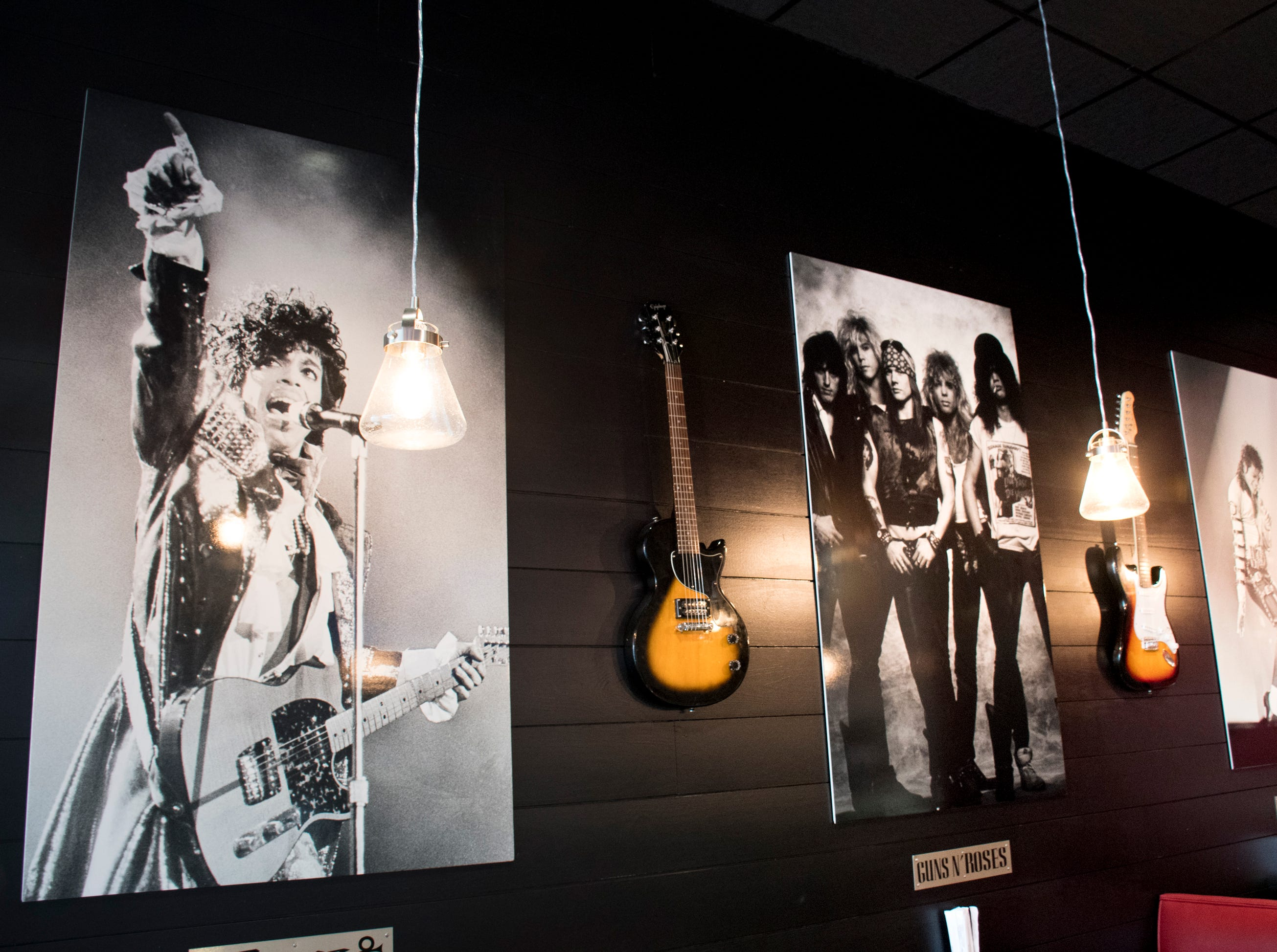 Posters of rock stars line the walls of the new Rock n' Roll Sushi restaurant in Gulf Breeze on Friday, January 18, 2019.
