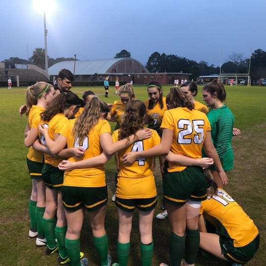 The Pensacola Catholic girls soccer team huddles before a match against West Florida on Jan. 17, 2019. The Crusaders will host this year's District 1-2A tournament.